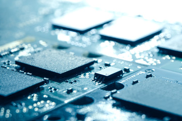 Close up Image of Electronic Circuit Board with Processors in Bright Light. Computer Technology Concept Background
