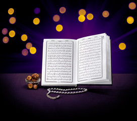 Open Holy Quran Book With Rosary and Dates