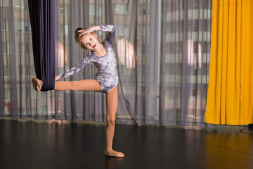 Little dancer in a aerial yoga hammock