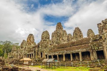Ancient ruins of Bayon Temple at Angkor area.