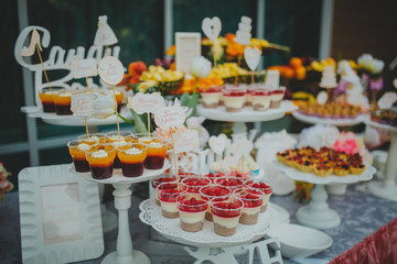 Beautiful sweets on buffet table with decorations