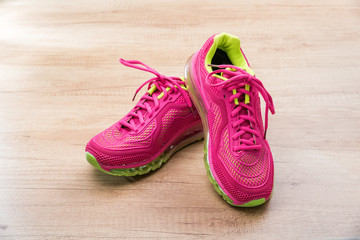 Jogging shoes on wooden background