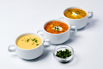 Different soups in plates