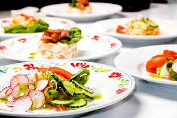Different spring salads in plates