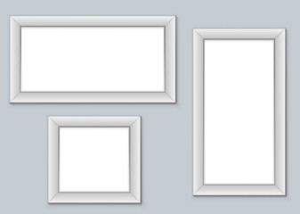 Blank picture frames hanging on the wall vector template.