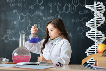 Inventive little scientist studying chemistry in the laboratory