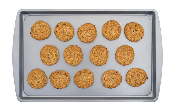 Top view of oatmeal cookies on a baking sheet isolated on a white background.