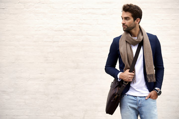Handsome dude in scarf and jacket, looking away Wall mural