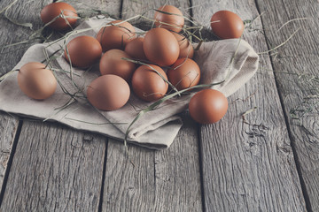 Fresh chicken brown eggs on rustic wood, organic farming concept