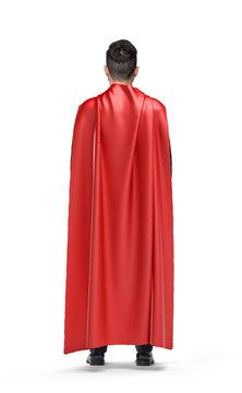 A businessman in shimmering scarlet cape turned back on white background.
