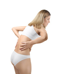 Young woman suffering from back pain on white background