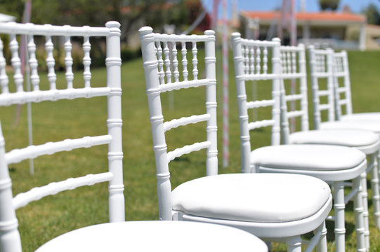Special event decorated area and white furniture on the green grass sunny outside background