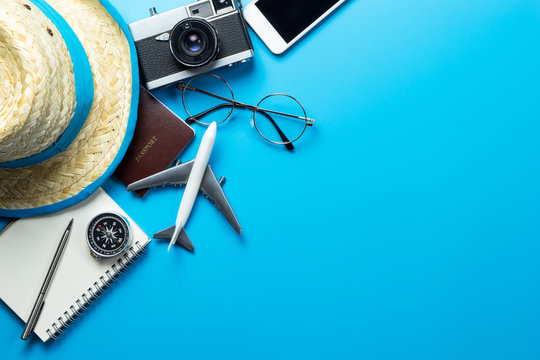 Travel accessories with copy space on blue background