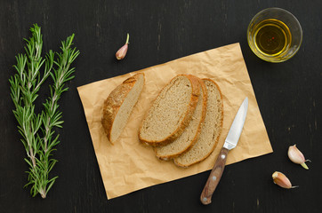 Bunch of rosemary with bread, garlic and olive oil