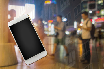 Blurred windows and city shopping concept with asian men and empty phone template ready to insert your logo or website.  Shoppers using their phones.