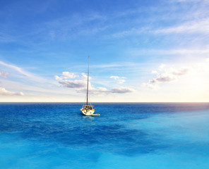 Sailing boat anchoring on open ocean, sailing and travel theme
