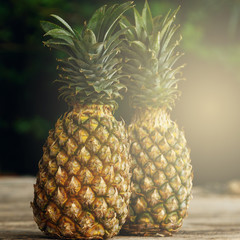 Pineapple fruits on wooden surface