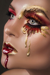 Female face with a beautiful creative makeup