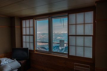 Window with Japanese alps in background