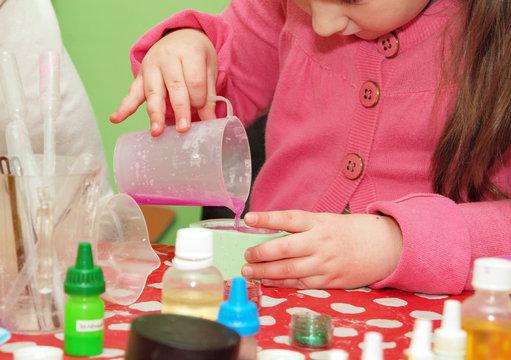 Homemade soap preparation. filling up of forms. children`s art