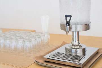 Drinking Water dispenser with Ice and Cup on Table for meeting, Seminar or conference room as Catering service concept