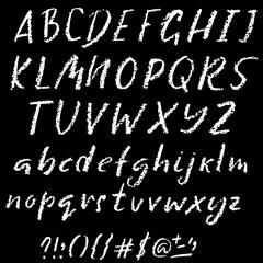 Handwritten vector chalked alphabet. Imitation texture of chalk. Modern hand drawn alphabet. Isolated letters. Vector illustration