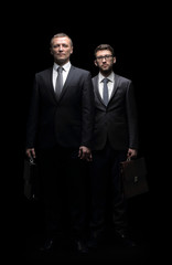Two corporate business colleagues isolated on black background