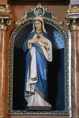 Immaculate heart of Mary statue on the altar in Parish Church of Saint Martin in Martinska Ves, Croatia on June 03, 2011.