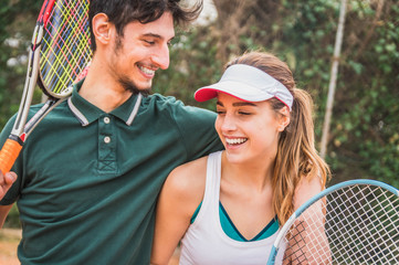 Happy couple of tennis player having fun.