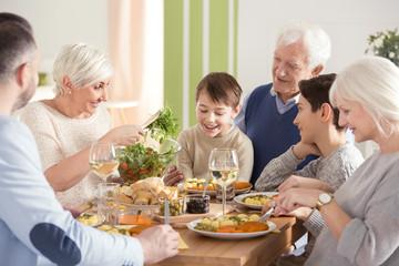 Happy big family eating dinner