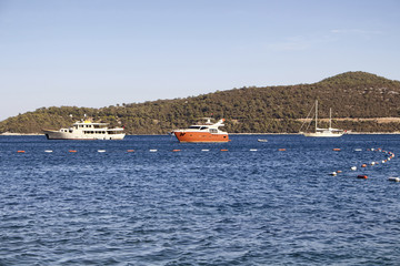 Luxury yachts parked in Turkbuku bay in Bodrum peninsula.