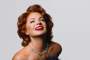 Beautiful Mature redhead woman in the image of Marilyn Monroe.