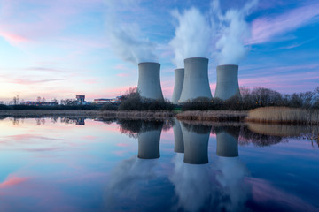 Nuclear power plant with dusk landscape. Wall mural