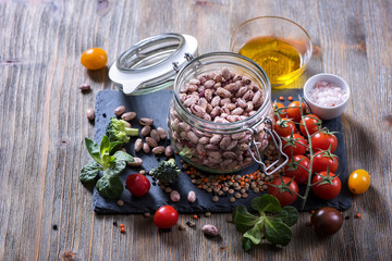 Cooking ingredients with vegetables, lentils, rice and beans in bowl, vegetarian and vegan food concept, copy space healthy food background