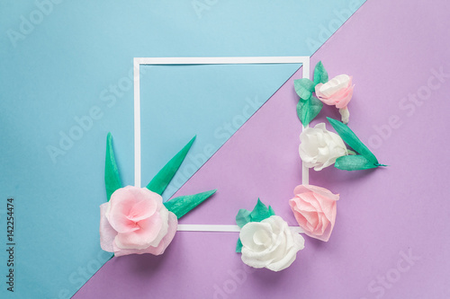 Square frame with color paper flowers on the blue and violet square frame with color paper flowers on the blue and violet background flat lay mightylinksfo