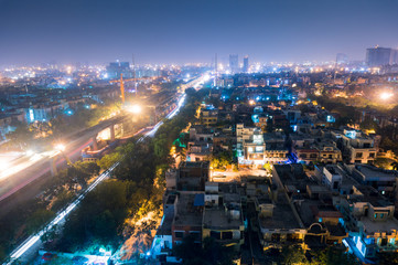 Cityscape of Noida Delhi at night with lights and under construction buildings