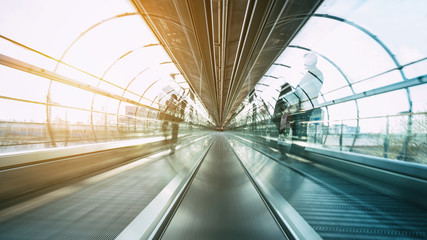 skywalk with blurred business people