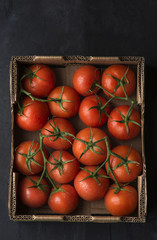 Whole tomatoes in cardboard box