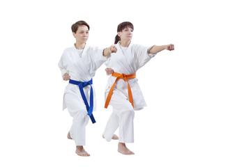 Girls in karategi are training punch hand