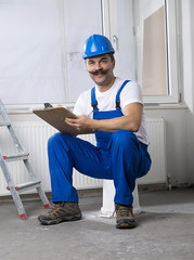 Construction Worker Holding Clipboard