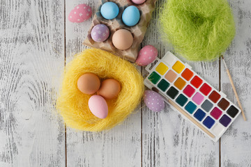 Festive easter decoration on white table with pastel color eggs