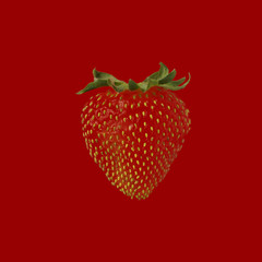 Red strawberry against  red background