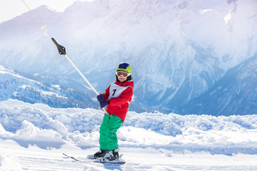 Portrait of boy using a button lift on the slope
