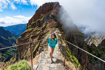 Tourist walking on the edge of the ridge.