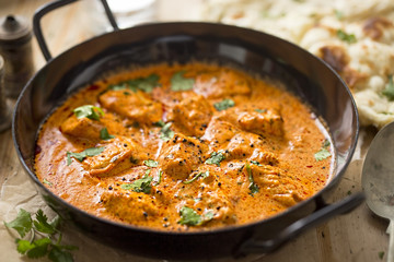 Foto op Plexiglas Kip Butter chicken curry with tender chicken breast, cream, butter & honey