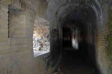 Dark passage inside a ruined castle