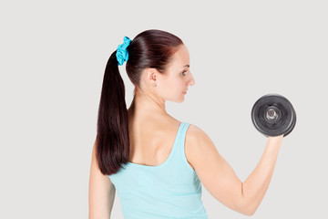 Fitness sports woman working out with dumbbells