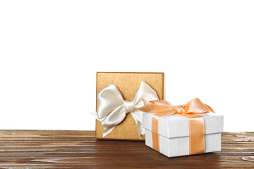 Beautiful gift boxes with satin ribbons on wooden table