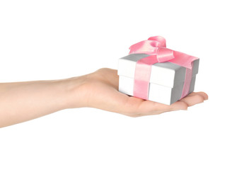 Hand holding beautiful gift box on white background