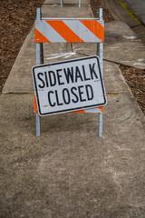 Sidewalk Closed Sign Askew with Copy Space Below
